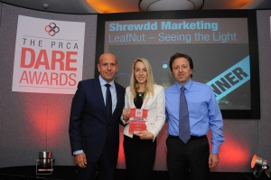 Alf Lombardi (right) together with Amelia Annakin from Shrewdd Marketing collect their award from Howard Kosky from marketeers4dc the main sponsor of the PRCA event.