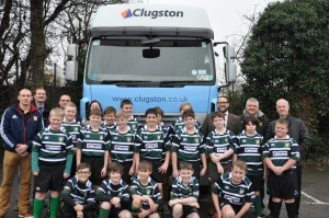 The Scunthorpe U12's rugby union team in the new kit with David Heath Head of Logistics at Clugston Distribution (far right).