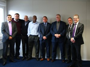 Photo Caption: Rasib Khan, far left, James Quinn, fourth from the right, and Russell Fletcher, far right, from Harvard Engineering with the Transport for London team. From left, Darren Horobin, William Nash, Brian Richmond, Shaun Hamer, and Dave Johnson.