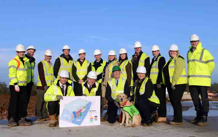 At the commencement of the build, back row from left, Debbie Ward of Clugston, Phil Mann of Faithful & Gould, Richard Hartshorne ofShires, Samuel Lewis of Clugston, Andrew Bloxham of F and G, Jonathan Davey of Associated Architects, Alison Potterton ofOne Creative Landscapes, Jenny Gilllies of One Creative Landscapes, Matt Goer of Associated Architects, Adam Wood of Shires, Jilly Rivers of Birmingham Dogs Home and Danny Dawson of Clugston. Front Row from left Richard Whitehead of Clugston, Simon Price of Chief Executive of Birmingham Dogs Home, Richard Temple Cox of Birmingham Dogs Home Chair of Trustees, Polly the dog and Alayna Warner of Birmingham Dogs Home.