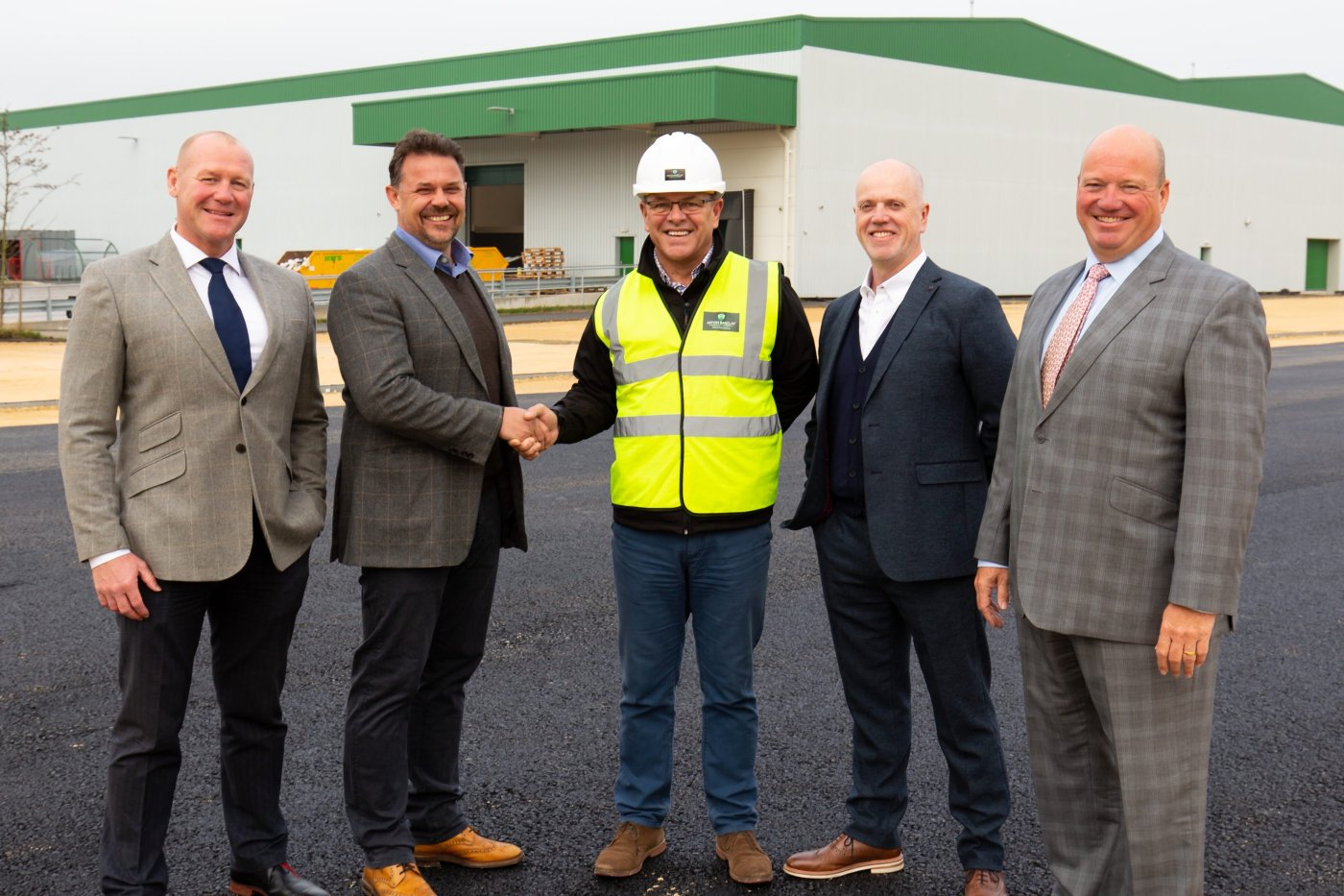 (from L-R) Simon Rhodes of Rhodes CRE with Illuminating Investments Director David Aspland, Roland Whittington, Project Director at Aston Barclay and Illuminating Investments Directors Michael McDonnell and John McDonnell, outside the new car auction centre at Photon Park